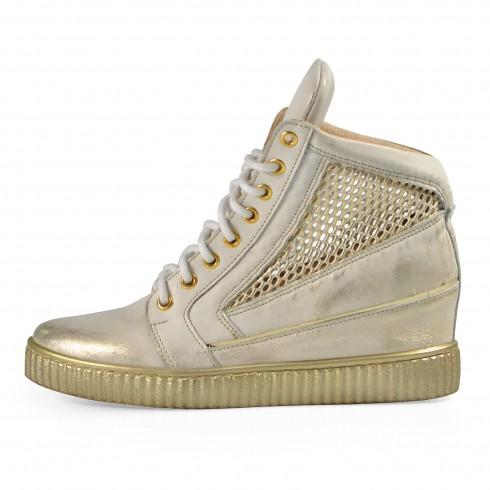 Sneakers z przecieranego złota